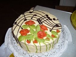 cake with flowers and musical notes