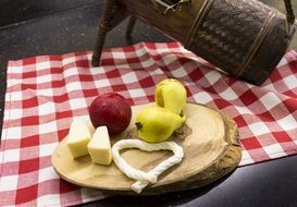 appetizer for wine in the form of cheese and apples