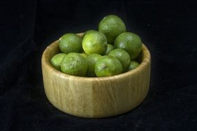 limes in a wooden bowl