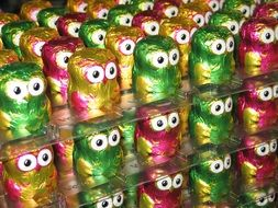 chocolate owls in colored wrappers