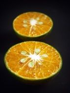 citrus slices on black