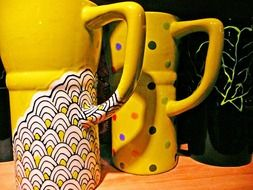 yellow ceramic cups with a pattern