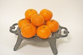 tangerines on an openwork stand