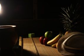 fruits on a table in a dark kitchen