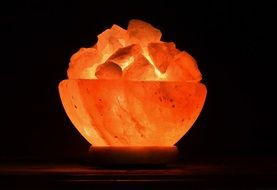 salt crystal lamp glows orange
