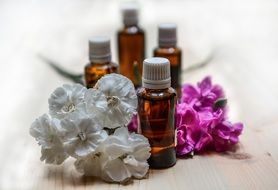essential oils with flowers close-up