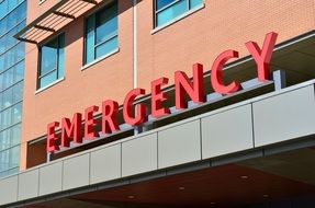 emergency sign on the facade of the hospital