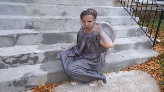 woman in grey costume of an angel