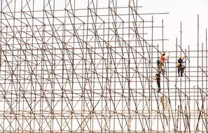Workers on Scaffolding Construction