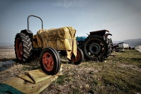 Old rusty tractor on the farm