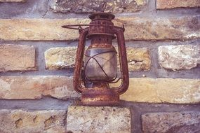 rusty antique lamp stands near the wall