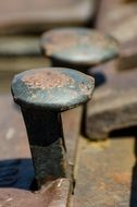 rusty railroad stakes