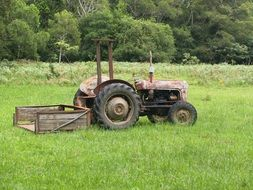 Old Tractor on green Field