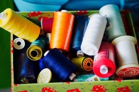 colored sewing thread in the box
