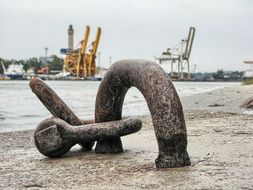 weathered shackle for ship chaining on pier close up
