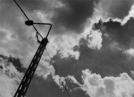 black and white photo of a pillar against the sky
