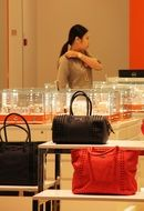 the seller of fashion bags in store