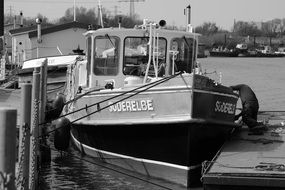 black and white image of a barge in the port of hamburg