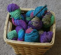 basket with knitting needles and wool