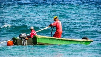 uniformed Workers in Boat on sea