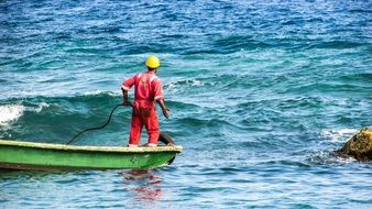 uniformed Worker in Boat on sea