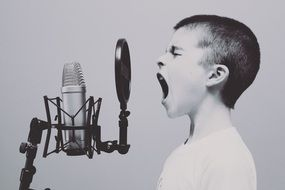 boy shouts into the microphone