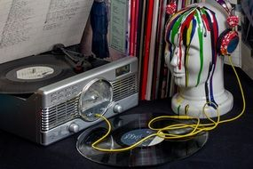 vintage vinyl record player and painted head mannequin in Headphones