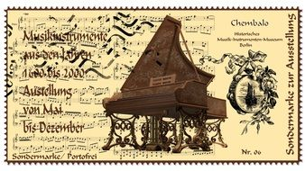 old postage stamp with the image of a piano