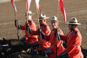 Mounted Canadian Policemen with flags
