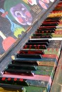 bright multicolored piano keys side view