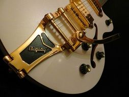 Photo of white electric guitar