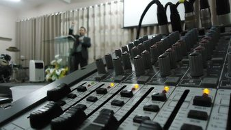 Table of Sound Mixer and Pastor in Church