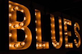 "word ""blues"" in bright light"