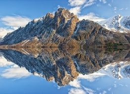mirror reflection of mighty mountains in a pond in Norway