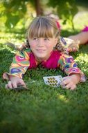 Girl playing cards