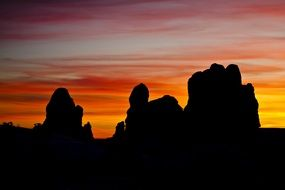 Sandstone Rock silhuettes at colorful sunset sky, usa, utah, arches national park
