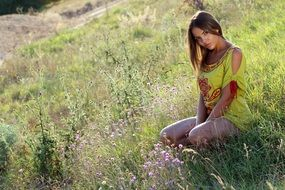 seductive girl on the grass