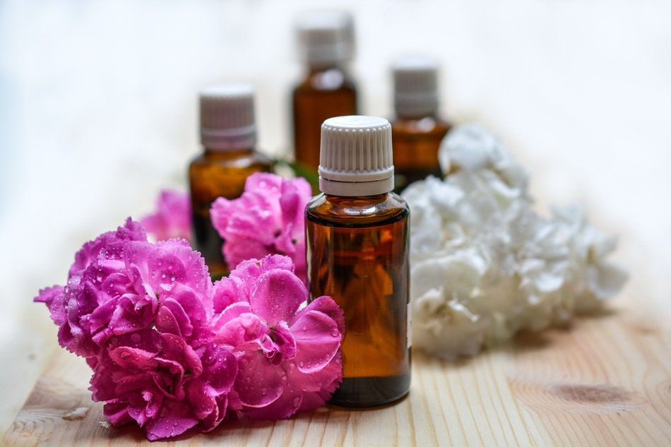 essential oils with flowers close up
