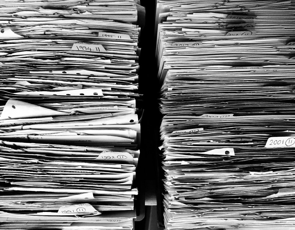 Black and white photo of papers in the office