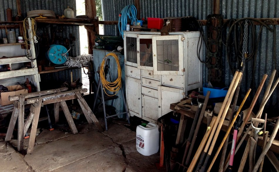 tools, carpentry table and chest of drawers in the barn