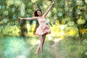 girl in a beautiful short dress in the forest