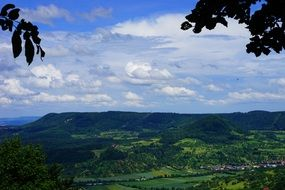 green forested mountains under blue sky, germany, swabian alb