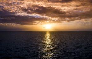the rays of the morning sun are reflected in the ocean