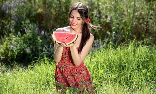 attractive young woman with watermelon