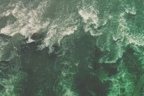 Waves in green ocean