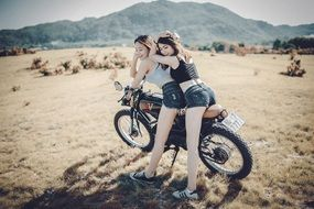 girls posing on a motorcycle