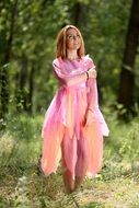 Girl in the fairy costume in the forest