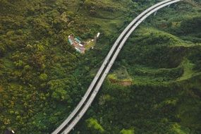 highway among green hills aerial view