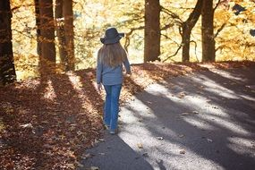 girl with long hair for a walk in the autumn park