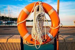 inflatable lifebuoy with rope on a ship